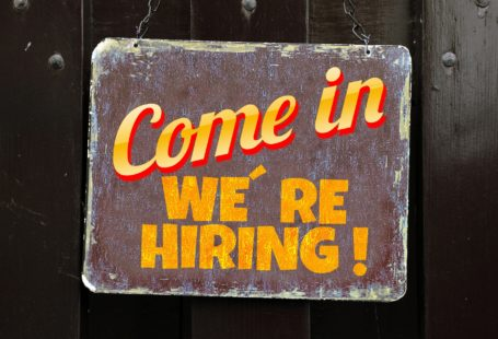 """weathered sign saying """"come in we're hiring"""""""